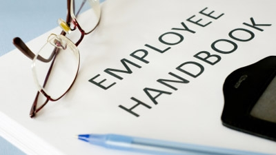Could you please advise me on how I should go about creating an employee handbook?