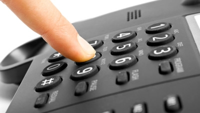 Where can we find a handset compatible with our current telephones in our office?
