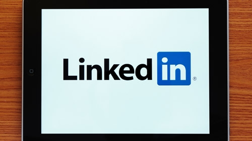 How can businesses effectively utilize social media, specifically LinkedIn, as a means of promotion?