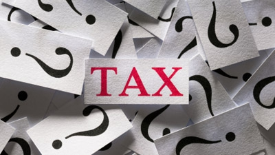 What factors are involved in outsourcing overseas when it comes to tax and accounting?