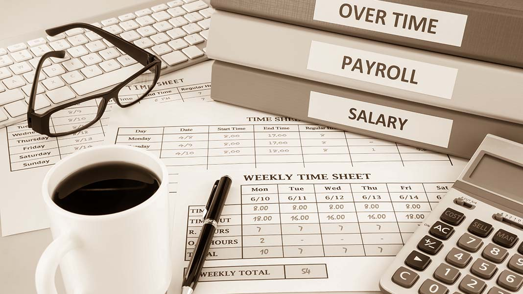 Should You Pay Employees Hourly or a Salary?